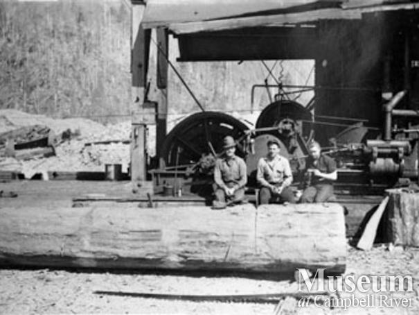 Loggers with a steam donkey in Phillips Arm