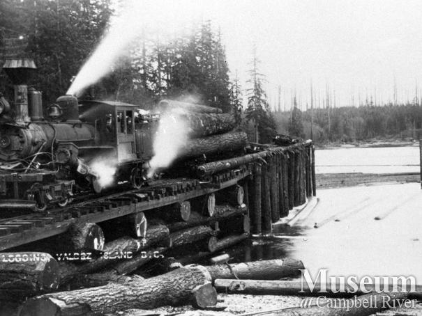 Logging locomotive on trestle