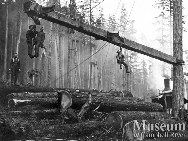 Loggers on loading boom at Elk Bay