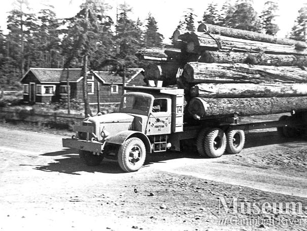 Loaded logging trucks at Oyster Bay