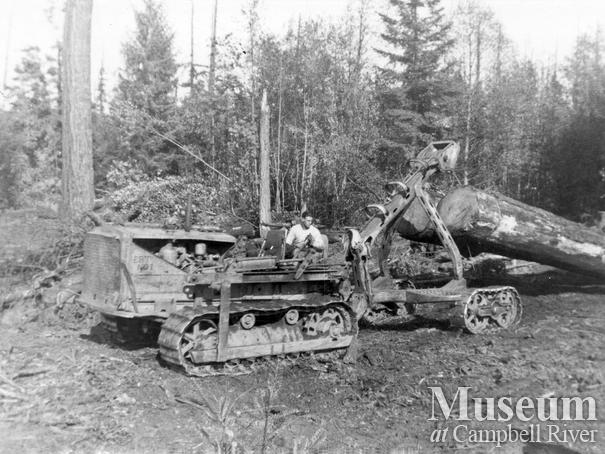 Elk River Timber Co. caterpillar skidding a log