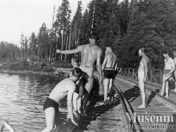 Elk River Timber Co. loggers on a swim break