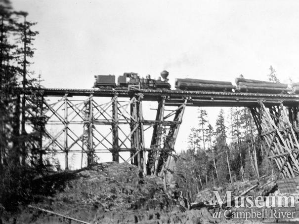 Locomotive on logging railroad trestle