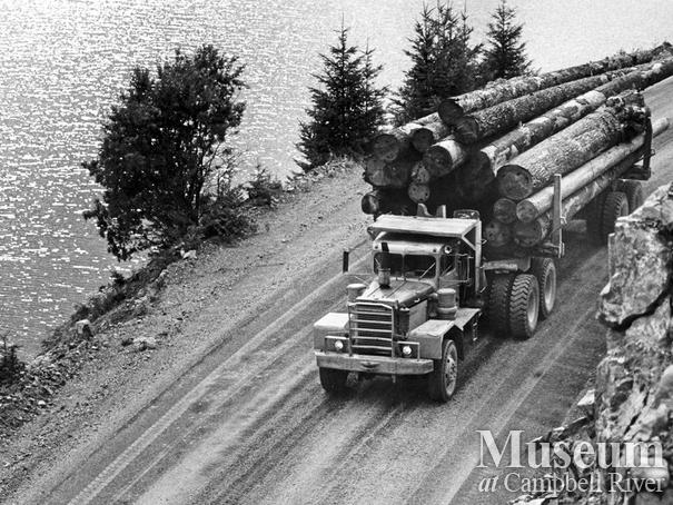 Logging truck with a load of logs