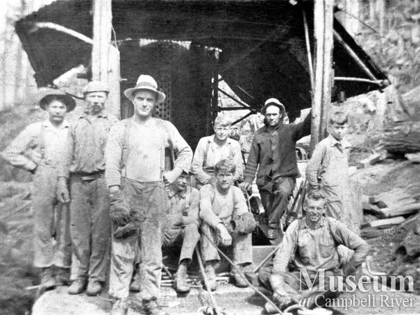 Bendickson Logging crew in front of a steam donkey
