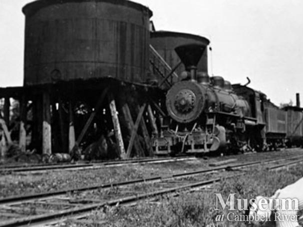 Elk River Timber Co. locomotive beside fuel tanks