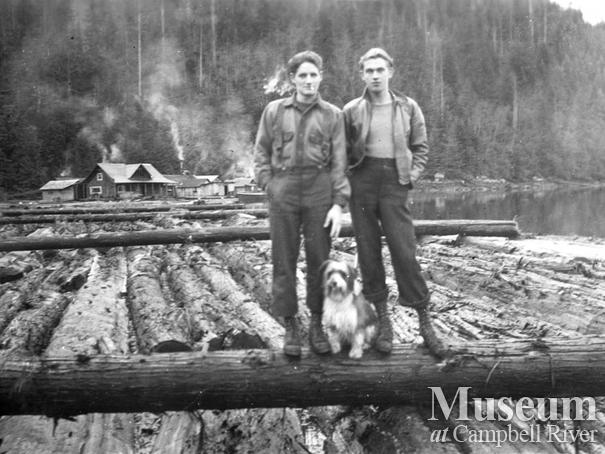 Loggers on boom at Call Inlet