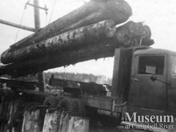Unloading a Pioneer Timber Co.logging truck