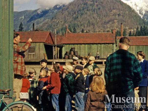 Kids at Woss post office, cookhouse in back