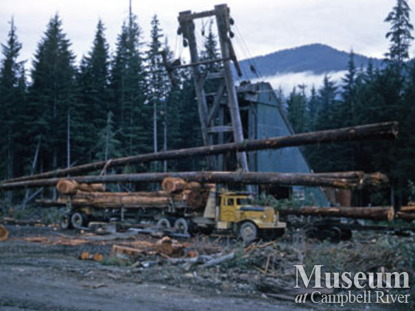 Loading TV tower poles near Woss camp