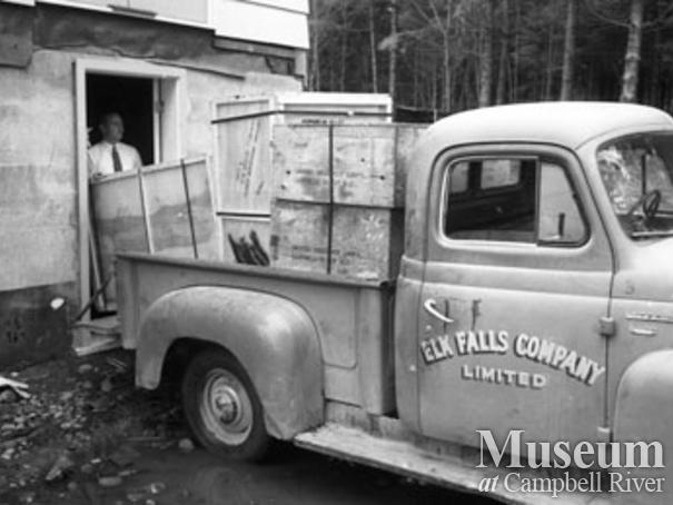 Elk Falls Co. truck being unloaded
