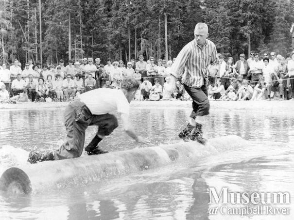 Log birling at Woss camp loggers sports event