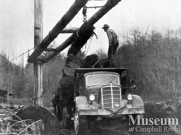 Logging truck being loaded at Fulmore Lake, Port Neville