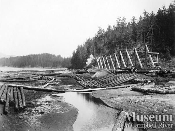 Unloading logs at Rock Bay